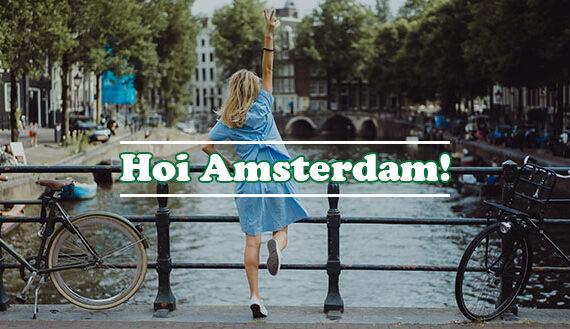 Tipps für deinen Trip nach Amsterdam Beitragsbild junge Frau am Kanal
